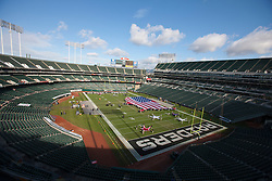 Nov 6, 2011; Oakland, CA, USA; General view of O.co Coliseum with an American flag on the field before the game between the Oakland Raiders and the Denver Broncos. Denver defeated Oakland 38-24. Mandatory Credit: Jason O. Watson-US PRESSWIRE