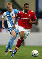 Photo: Paul Thomas.<br /> Chester City v Nottingham Forest. The Carling Cup. 14/08/2007.<br /> <br /> Kelvin Wilson (R) is chased by Nathan Lowndes of Chester.