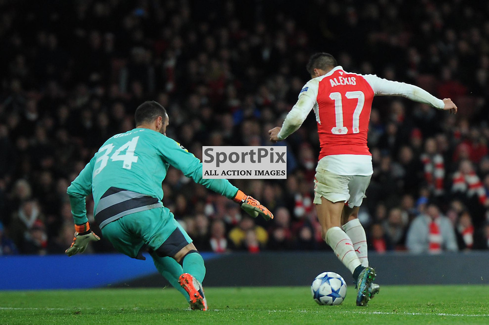 Arsenals Alexis Sanchez rounds the keeper to score his second goal during the Arsenal v Dinamo Zagreb game in the UEFA Champions League on the 24th November 2015 at the Emirates Stadium.