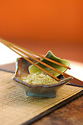 Organic Bamboo-Infused Jade Pearl Rice in a turquoise Japanese ceramic bowl with a green leaf ceramic scoop