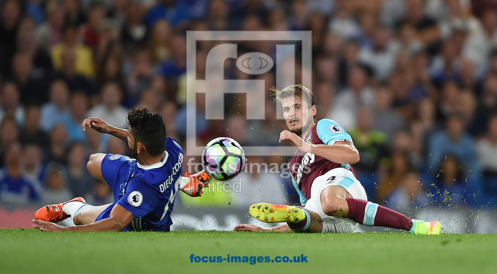 Chelsea's Diego Costa and Havard Nordtveit of West Ham United during the Premier League match at Stamford Bridge, London<br /> Picture by Daniel Hambury/Focus Images Ltd +44 7813 022858<br /> 15/08/2016
