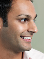 Mid adult man looking away and smiling close-up
