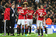 Marouane Fellaini Midfielder of Manchester United congratulates Marcus Rashford Forward of Manchester United during the EFL Cup Final between Manchester United and Southampton at Wembley Stadium, London, England on 26 February 2017. Photo by Phil Duncan.