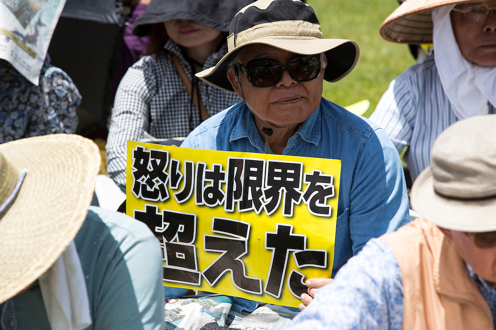 OKINAWA, JAPAN - JUNE 19 : Thousands of people gather in a prefectural action to pray for rape victim and to oppose the U.S. Airbase relocation to Henoko at Ohnoyama General Athletic Field at the Ohnoyoma Park and sports complex in central Naha, Okinawa on June 19, 2016. Around 65,000 people gathered at the rally, protests have grown more intense in the past days due to the past incident of rape of a Japanese woman and drunk driving in Okinawa over American military presence in Japan. Photo: Richard Atrero de Guzman