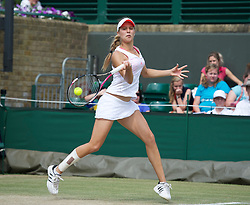 LONDON, ENGLAND - Sunday, July 3, 2011: Eugenie Bouchard (CAN) his the winning point during the Girls' Doubles Final match on day thirteen of the Wimbledon Lawn Tennis Championships at the All England Lawn Tennis and Croquet Club. (Pic by David Rawcliffe/Propaganda)