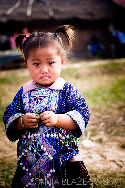 Laos, Muang Sing. A little Hmong girl during the Hmong New Year's festival.