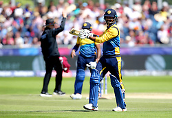 Sri Lanka's Dimuth Karunaratne walks off the pitch after being caught out by West Indies' Shai Hope during the ICC Cricket World Cup group stage match at The Riverside Durham, Chester-le-Street.