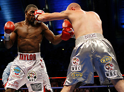September 29, 2007; Atlantic City, NJ, USA; Undisputed Middleweight Champion Jermain Taylor (white trunks) and challenger Kelly Pavlik (silver trunks) trade punches during their 12 round bout at Boardwalk Hall in Atlantic City, New Jersey.