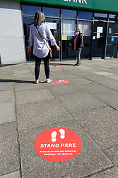 Safe distance markings outside Lloyds Bank, during Coronavirus lockdown, UK May 2020