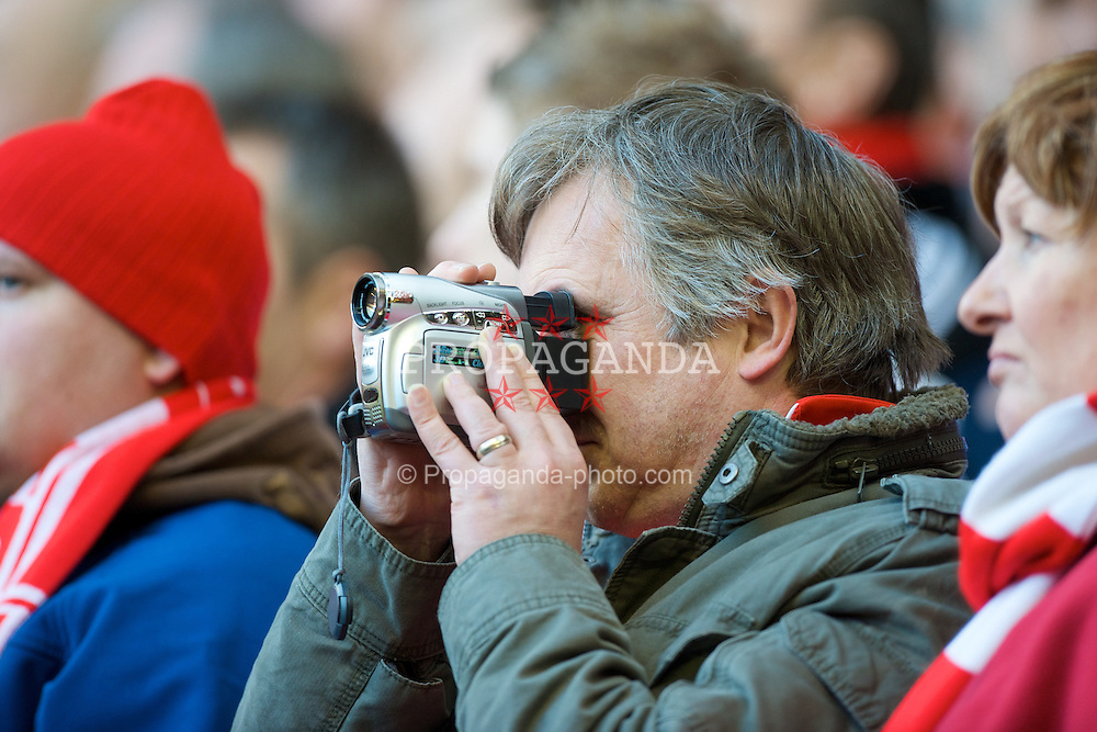 LIVERPOOL, ENGLAND - Saturday, March 8, 2008: A Liverpool supporter films the action on his video camera during the Premiership match at Anfield. (Photo by David Rawcliffe/Propaganda)