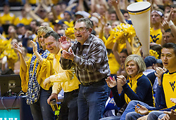 Jan 24, 2017; Morgantown, WV, USA; West Virginia Mountaineers fans celebrate after a timeout was called during the second half against the Kansas Jayhawks at WVU Coliseum. Mandatory Credit: Ben Queen-USA TODAY Sports