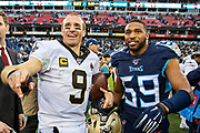NASHVILLE, TN - DECEMBER 22:  Drew Brees #9 of the New Orleans Saints talks after the game with Wesley Woodyard #59 of the Tennessee Titans at Nissan Stadium on December 22, 2019 in Nashville, Tennessee. The Saints defeated the Titans 38-28.  (Photo by Wesley Hitt/Getty Images) *** Local Caption *** Drew Brees; Wesley Woodyard
