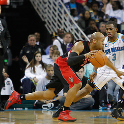 January 17, 2011; New Orleans, LA, USA; Toronto Raptors guard Sundiata Gaines (2) drives past New Orleans Hornets point guard Chris Paul (3) during the second quarter at the New Orleans Arena.   Mandatory Credit: Derick E. Hingle