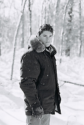 Man in a winter coat outdoors in the woods