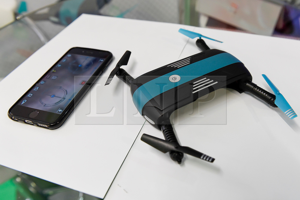 © Licensed to London News Pictures. 24/01/2016. London, UK. Richard Mire, of RDM Creations, presents a pocket drone, controlled by a smartphone (pictured) at the opening day of the Toy Fair 2017, taking place at Kensington Olympia.  The trade show brings together many of the leading toy manufacturers and distributors and offers a chance for buyers to see the latest toys in preparation for Christmas. Photo credit : Stephen Chung/LNP