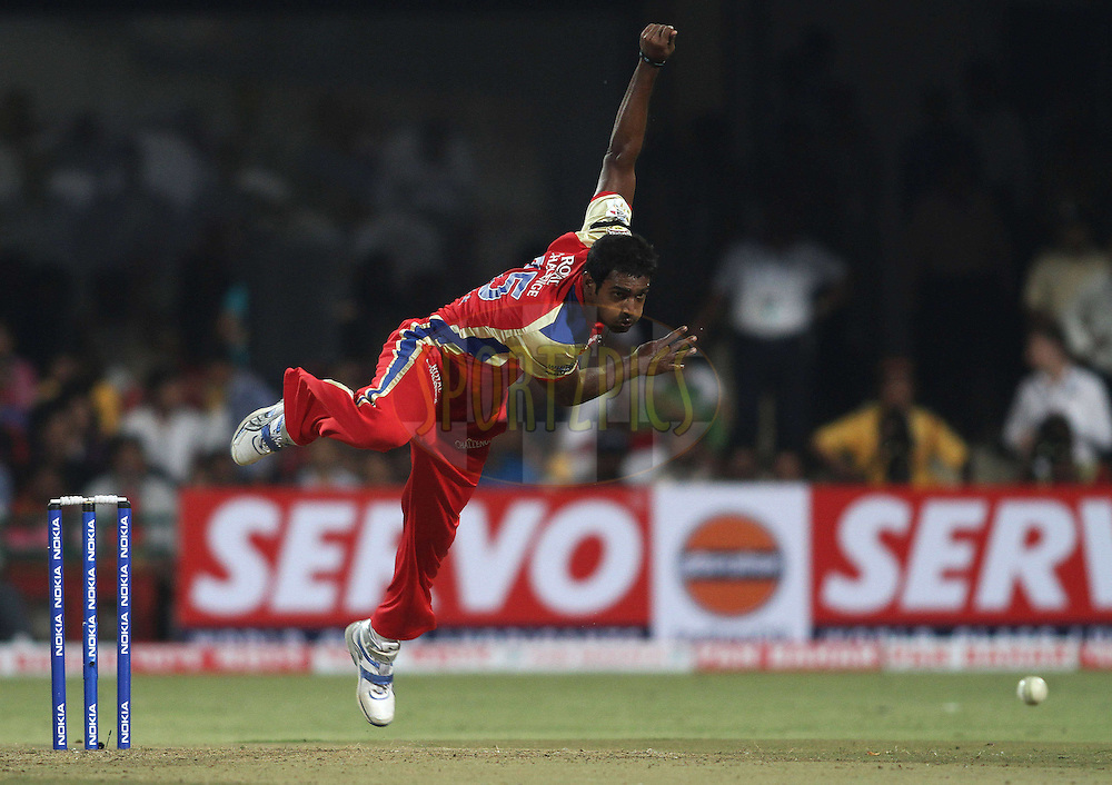 Abhimanyu Mithun of Royal Challengers Bangalore sends down a delivery during match 1 of the NOKIA Champions League T20 ( CLT20 )between the Royal Challengers Bangalore and the Warriors held at the  M.Chinnaswamy Stadium in Bangalore , Karnataka, India on the 23rd September 2011..Photo by Shaun Roy/BCCI/SPORTZPICS