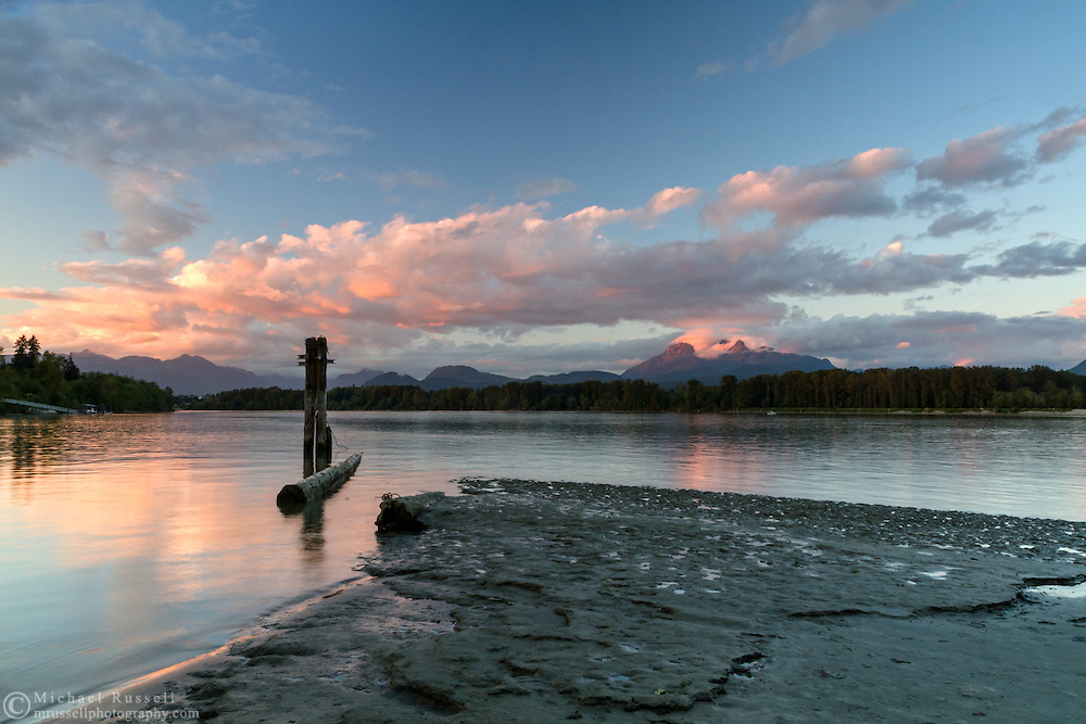 Sunset at Tavistock Point and the junction of the Fraser River and Bedford Channel at Brae Island Regional Park in Langley, British Columbia, Canada.  Mount Blandshard (The Golden Ears) is in the background.