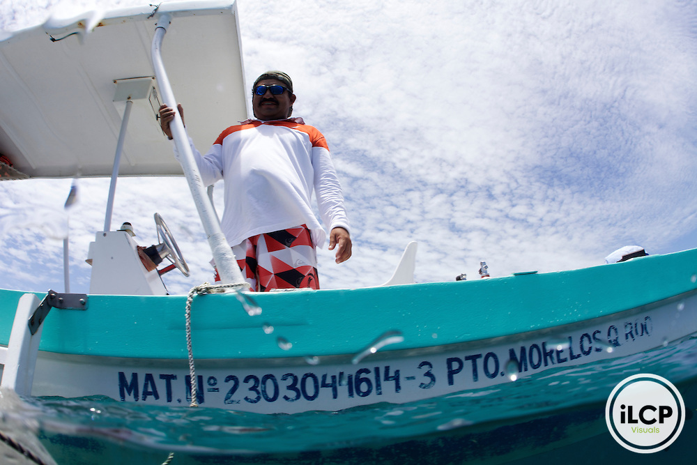 An example of small scale reef based tourism:  Pedro Pablo Peaza drives recreational tourism boat.  He was in a fishing coorporative for 15 years but about 12 years ago he moved into tourism for more reliable income.