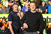Forest Green Rovers assistant manager, Scott Lindsey and Forest Green Rovers manager, Mark Cooper during the EFL Sky Bet League 2 second leg Play Off match between Forest Green Rovers and Tranmere Rovers at the New Lawn, Forest Green, United Kingdom on 13 May 2019.