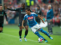 EDINBURGH, SCOTLAND - JULY 28: <br /> Napoli Right Winger, Simone Verde, gets away from Liverpool's Dutch midfielder, Georginio Wijnaldum, during the Pre-Season Friendly match between Liverpool FC and SSC Napoli at Murrayfield on July 28, 2019 in Edinburgh, Scotland. (Photo by MB Media)