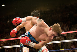 There's no question who is #1 pound for pound. Manny Pacquiao (49-3-2, 37 KOs) destroyed IBO light welterweight Ricky Hatton (45-2, 32 KOs) on Saturday night at the MGM Grand Garden Arena in Las Vegas. Hatton came out aggressively but was dropped by twice by Pacquiao in round one. In round two, Pacquiao dropped Hatton for the count with a left to the chin. Time was 2:59. Hatton was down for several minutes..