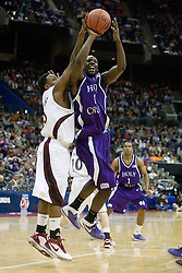 Holy Cross Crusaders guard Torey Thomas (1) shoots against SIU.  The #4 seed Southern Illinois Salukis defeated the #13 seed Holy Cross Crusaders 61-51  in the first round of the Men's NCAA Tournament in Columbus, OH on March 16, 2007.