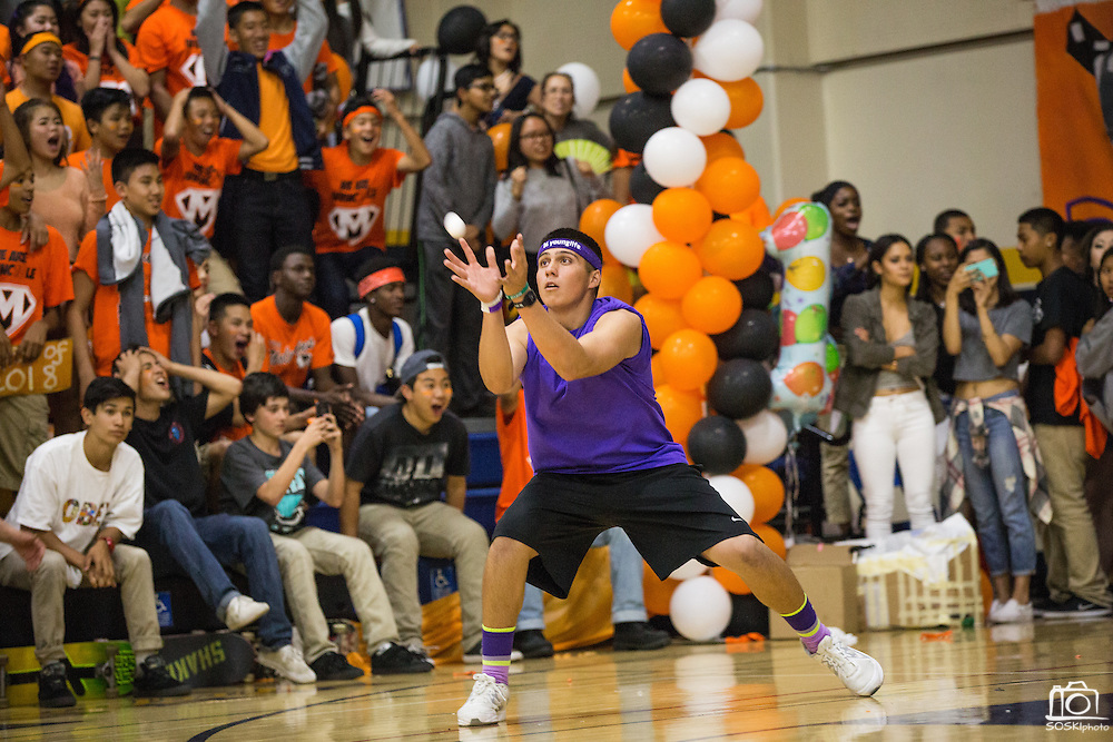 Milpitas High School seniors catch an egg during the Egg Toss during the annual Trojan Olympics, where students compete in various unorthodox events for class bragging rights, at Milpitas High School in Milpitas, California, on March 27, 2015. (Stan Olszewski/SOSKIphoto)
