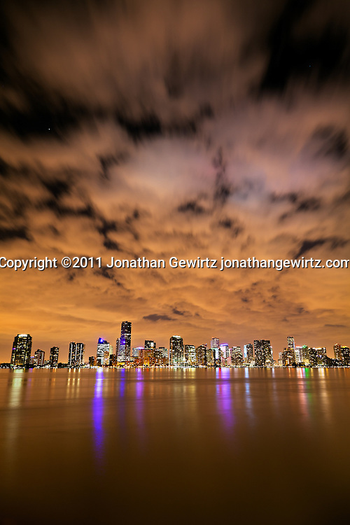 The downtown Miami bayfront at night, showing hotels, condos and office buildings. WATERMARKS WILL NOT APPEAR ON PRINTS OR LICENSED IMAGES.