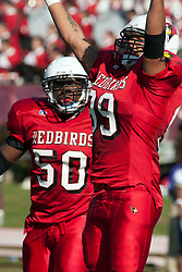29 October 2005: Redbird James Stevenson III and Montel Connor celebrate. With a final score of 31 - 17, Western Illinois University Leathernecks collared the Illinois State University Redbirds knocking them from their 18th ranked perch at Hancock Field on Illinois State's campus in Normal IL