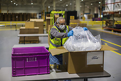 """Ford is expanding its efforts to design and produce urgently needed medical equipment and supplies for health care workers, first responders and patients fighting coronavirus.<br /> <br /> In addition to the current production of more than 3 million face shields in Plymouth, Mich., Ford-designed powered air-purifying respirator production begins Tuesday, April 14. Ford also is now producing face masks and leading an effort to scale production of reusable gowns for health care workers. Lastly, Ford started providing manufacturing expertise to help scientific instrument provider Thermo Fisher Scientific quickly expand production of COVID-19 collection kits to test for the virus.<br /> <br /> """"We knew that to play our part helping combat coronavirus, we had to go like hell and join forces with experts like 3M to expand production of urgently needed medical equipment and supplies, said Jim Baumbick, vice president, Ford Enterprise Product Line Management. """"In just three weeks under Project Apollo, we've unleashed our world-class manufacturing, purchasing and design talent to get scrappy and start making personal protection equipment and help increase the availability and production of ventilators.""""<br /> <br /> Ford and 3M Collaboration Leads to New PAPR<br /> Since late March, Ford manufacturing, purchasing and supply chain experts have been embedded at 3M manufacturing facilities to help increase production of urgently needed products.<br /> <br /> With this additional help, 3M and Ford were able to increase the output of PAPRs and N95 respirators at 3M's U.S.-based manufacturing facilities. <br /> <br /> """"3M is dedicated to helping to protect our heroic health care workers and first responders globally, including sharing our scientific expertise to increase supply of needed PPE,"""" said Bernard Cicut, vice president, 3M Personal Safety Division. """"We are proud to stand together with Ford in this effort, as they have helped us increase manufacturing of existing 3M PPE pr"""