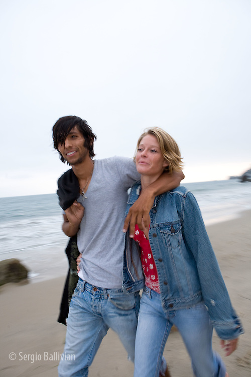Lifesytle portraits of a young couple on the beach in Malibu, CA