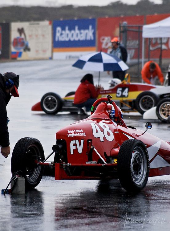 Racecars wait to enter the track on a rainy day, during an SCCA event at Laguna Seca