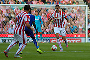 Stoke City's Geoff Cameron wins the ball in midfield during the Barclays Premier League match between Stoke City and Leicester City at the Britannia Stadium, Stoke-on-Trent, England on 19 September 2015. Photo by Aaron Lupton.