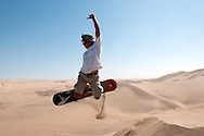Gerson Valle takes a jump built in the sand dunes outside of Huacachina in Peru.