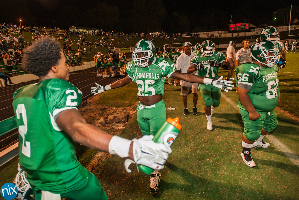 A.L. Brown's Caleb Rose (25) celebrates with Steven Howie (2) as the final seconds tick away Thursday night during the Battle for the Bell at Kannapolis Memorial Stadium. Kannapolis defeated Concord 26-15.