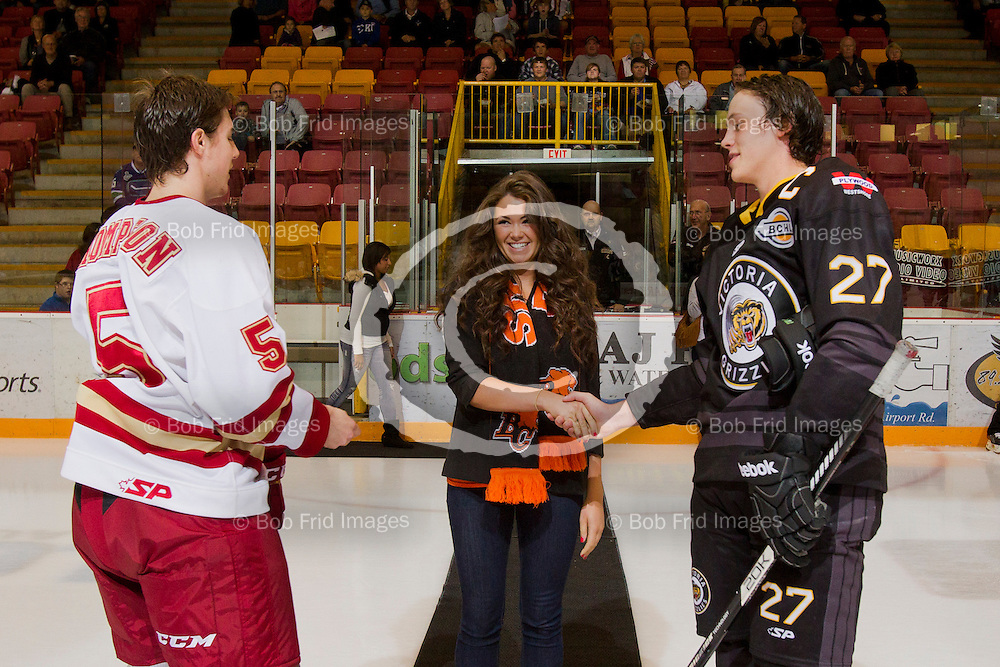22 September 2012:  David Thompson (5) of the Chiefs, Zach Urban (27) of the Grizzlies  during a game between the Chilliwack Chiefs and the Victoria Grizzlies at  Prospera Centre, Chilliwack, BC.    Final Score: Chilliwack 2  Victoria 4   ****(Photo by Bob Frid - All Rights Reserved 2012): mobile: 778-834-2455 : email: bob.frid@shaw.ca ****