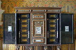 Chateau de Chenonceau: An ornate 16th century Italian cabinet, decorated with mother-of-pearl and pen engraved ivory plaques, holds pride of place in the Francois I bedroom.  It was a wedding present to Francois II and Mary Stuart.