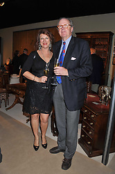 The HON.CHRISTOPHER & MRS GILMOUR at a preview evening of the annual London LAPADA (The Association of Art & Antiques Dealers) antiques Fair held in Berkeley Square, London on 20th September 2011.