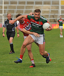 Mayo&rsquo;s Aidan O&rsquo;Shea breaking through tackles against Cork at the Gaelic grounds.<br /> Pic Conor McKeown