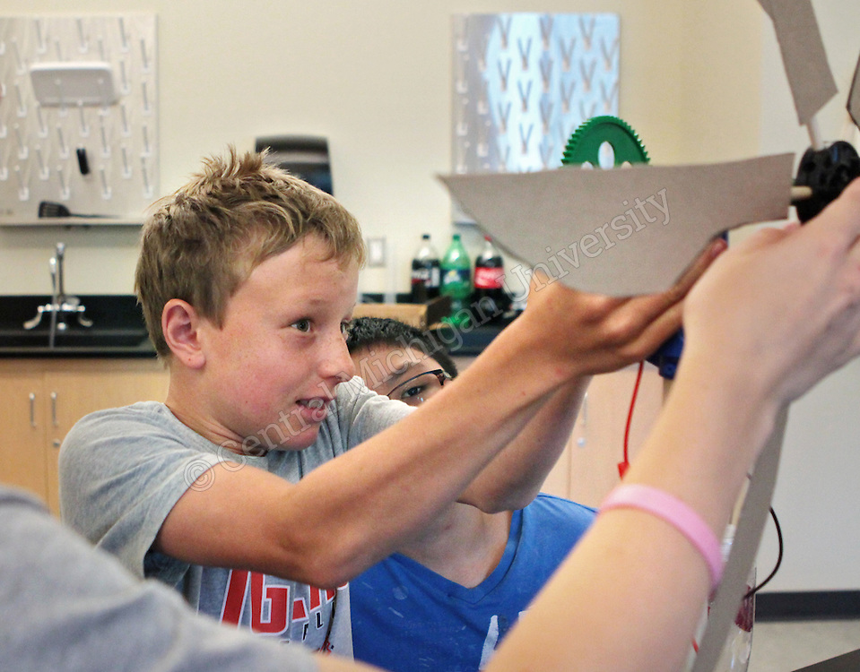 """Fifth through eighth grade students used science, technology, engineering and math to build robots, create circuits, code games and investigate electronics at """"Tinkering and Technology,"""" a camp offered through CMU's Center for Excellence in STEM Education photo by Emily Mesner"""