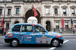 © Licensed to London News Pictures.05/12/2013. London, UK. A decorated London taxi arrives for the opening of the new Cath Kidston store at 180 Piccadilly, London. The new store is the largest Cath Kidston store in the world and  has over 20,000 products, including new ranges and services.Photo credit : Peter Kollanyi/LNP