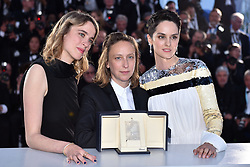 """Celine Sciamma, winner of the Best Screenplay award for her film """"Portrait de la Jeune Fille en Feu"""", poses with Noemie Merlant (R) and Adele Haenel (L) at the winner photocall during the 72nd annual Cannes Film Festival on May 25, 2019 in Cannes, France. Photo by Lionel Hahn/ABACAPRESS.COM"""