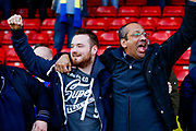 AFC Wimbledon fans celebrate during the EFL Sky Bet League 1 match between Walsall and AFC Wimbledon at the Banks's Stadium, Walsall, England on 14 April 2018. Picture by Simon Davies.