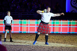 © Licensed to London News Pictures. 15/05/2016. Windsor, UK.  Highland games being played. An evening event held at the Royal Windsor Horse show to celebrate the 90th birthday of HRH Queen Elizabeth II. Acts from arounds the world have been invited to perform at the evening event, set in the grounds of Windsor Castle. Photo credit: Ben Cawthra/LNP