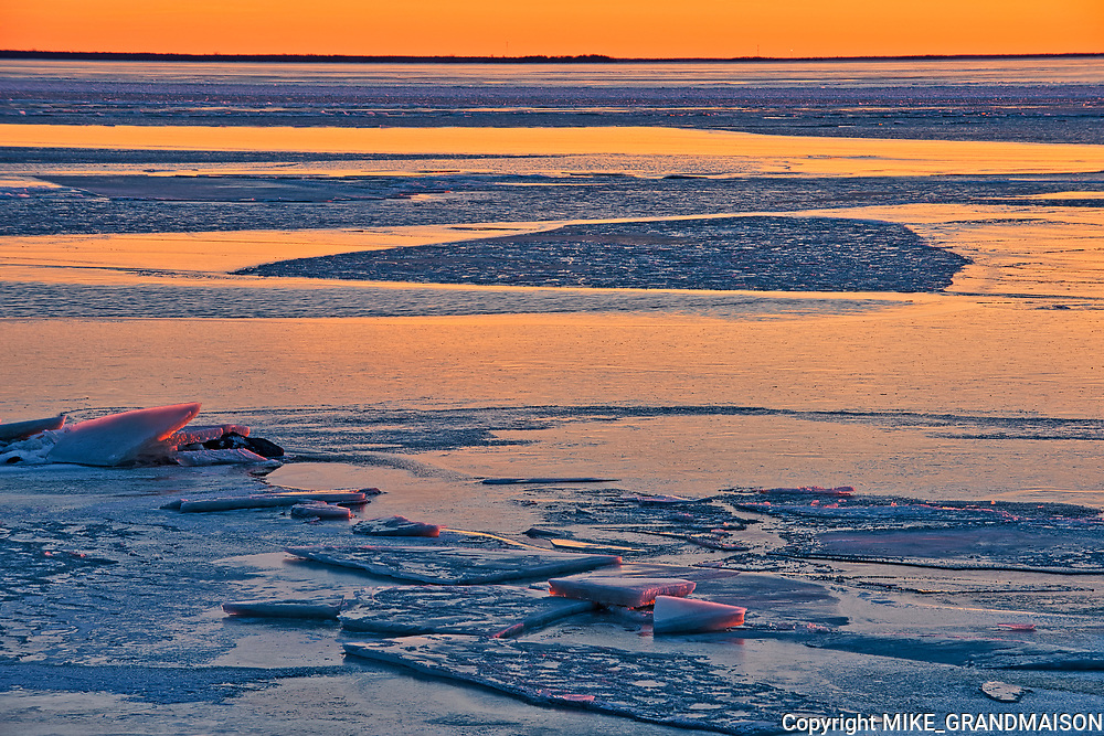Ice at sunset on frozen Lake Winnipeg <br />Balsam Bay<br />Manitoba<br />Canada