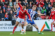 Swindon midfielder Louis Thompson and Wigan's Max Power battle for the ball during the Sky Bet League 1 match between Swindon Town and Wigan Athletic at the County Ground, Swindon, England on 25 March 2016. Photo by Shane Healey.