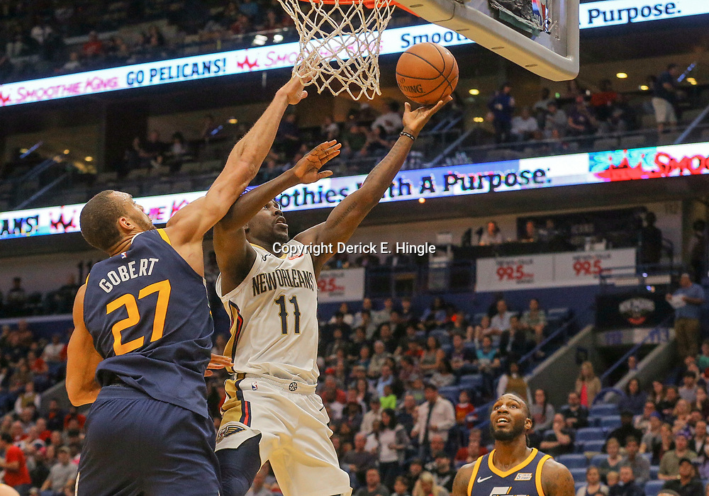 Mar 11, 2018; New Orleans, LA, USA; New Orleans Pelicans guard Jrue Holiday (11) shoots over Utah Jazz forward Joe Ingles (2) during the first half at the Smoothie King Center. Mandatory Credit: Derick E. Hingle-USA TODAY Sports