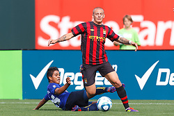 July 16, 2011; San Francisco, CA, USA;  Manchester City midfielder Vladimir Weiss (40) is tackled by Club America midfielder Juan Carlos Medina (26) during the first half at AT&T Park. Manchester City defeated Club America 2-0.