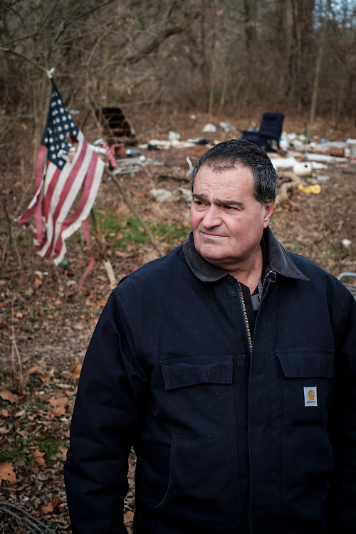 ELKTON, MARYLAND - DECEMBER 26: Zane Cambell wanders through a deserted homeless encampment in the woods near his home in Elkton, Maryland on Tuesday, December 26, 2017 in Elkton, Maryland. Campbell likes to talk about how he feels his life is in shambles after a long history of alcoholism. Campbell was born into one of the most revered clans of old-time country music. His aunt was the legendary singer-songwriter Ola Belle Reed, and his uncle was Alex Campbell, a bluegrass singer who hosted shows at the country music parks along the Pennsylvania/Maryland border. (Photo by Pete Marovich For The Washington Post)