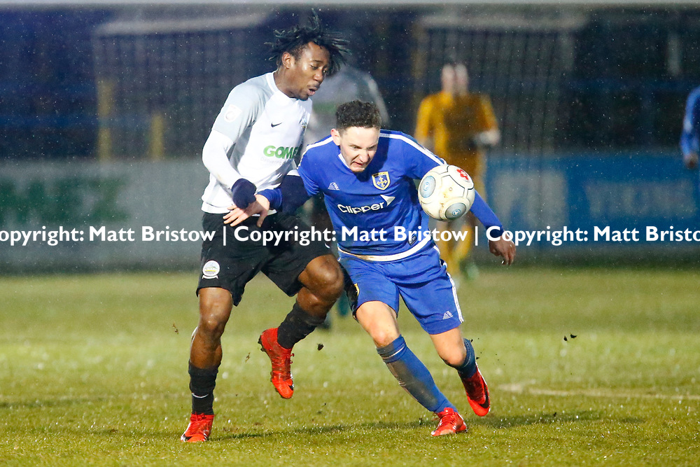 Guiseleys midfielder Callum McFadzean keeps Dover's forward Kadell Daniel from the ball during the Vanorama National League match between Dover Athletic and Guiseley at Crabble Stadium, London, England on 27 January 2018. Photo by Matt Bristow.